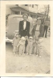 Granny, left, holds my hand and those of my twin cousins with their other grandmother.